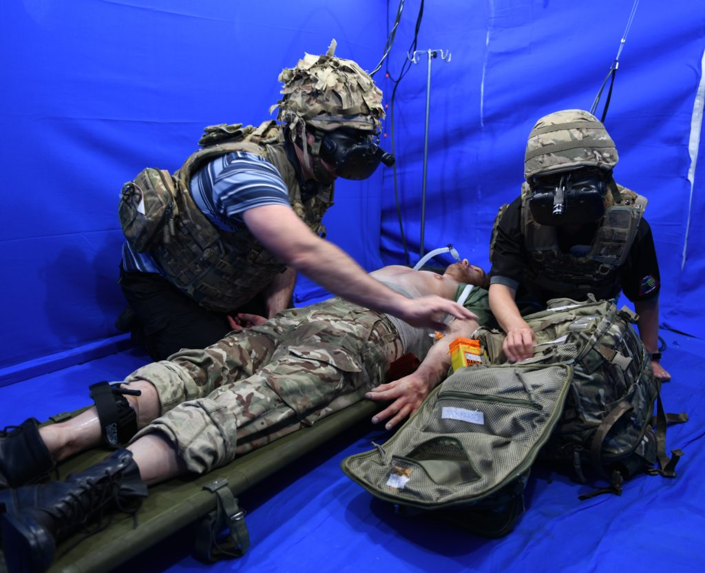 Defence paramedics from RAF Brize Norton's Tactical Medical Wing taking part in a Mixed Reality training trial, using camera-modified VR headsets